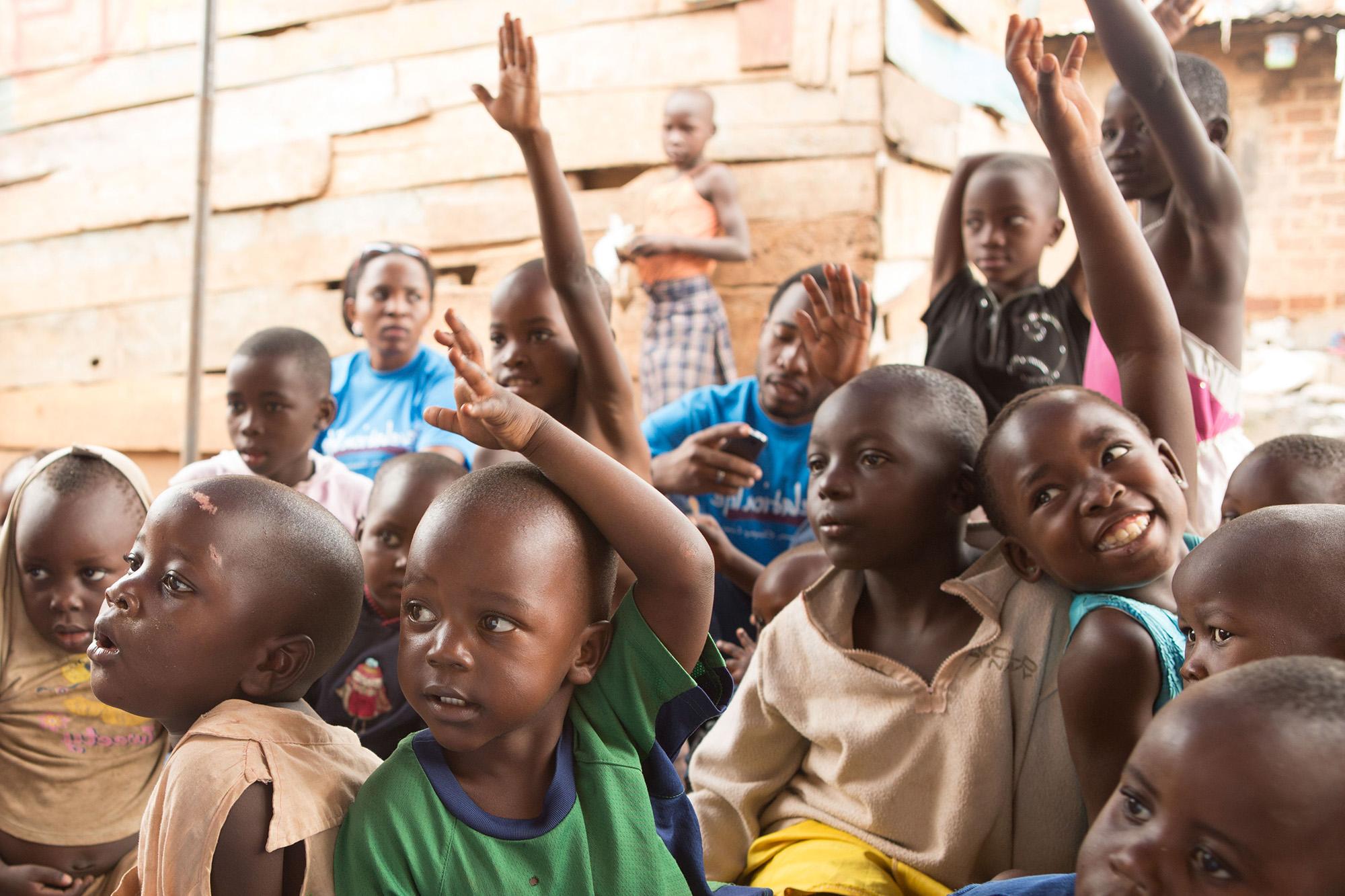 children volunteering, putting their hands up